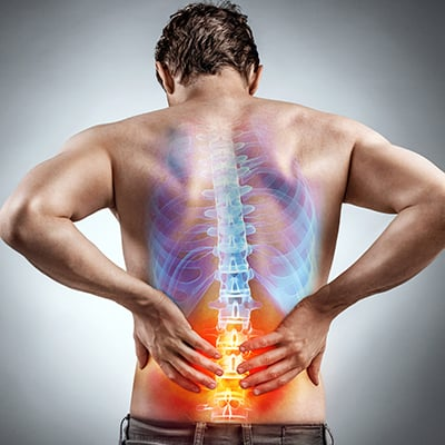 Man suffering from back pain - PostureWorks